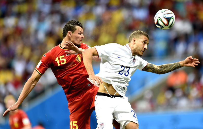 Belgium's Daniel Van Buyten competes for a header with Fabian Johnson of the U.S. during a Round of 16 match between Belgium and the U.S. of 2014 FIFA World Cup at .