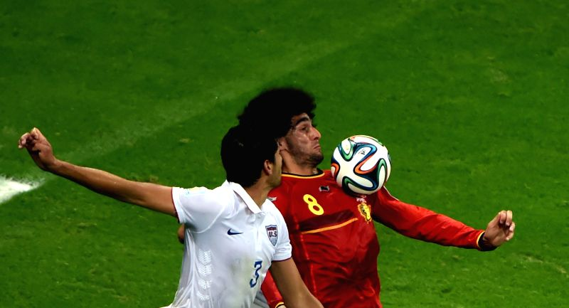 Belgium's Marouane Fellaini (R) vies with Omar Gonzalez of the U.S. during a Round of 16 match between Belgium and the U.S. of 2014 FIFA World Cup at the Arena ...