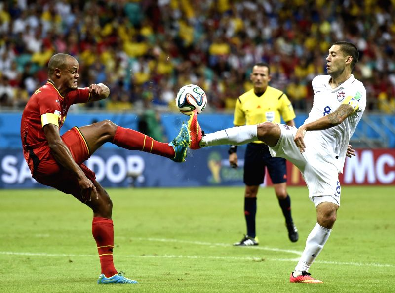 Clint Dempsey (R) of the U.S. vies with Belgium's Vincent Kompany during a Round of 16 match between Belgium and the U.S. of 2014 FIFA World Cup at the Arena Fonte .