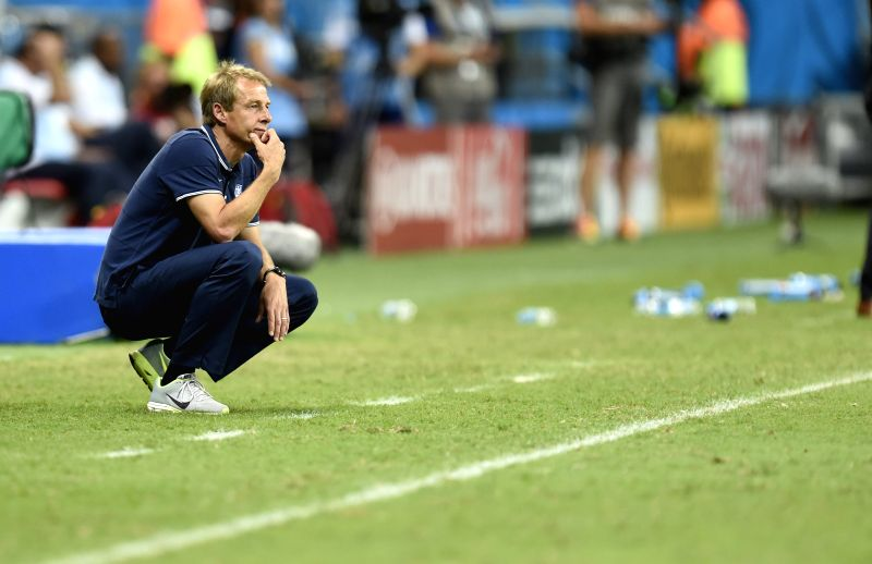 Jurgen Klinsmann, coach of the U.S. looks on during a Round of 16 match between Belgium and the U.S. of 2014 FIFA World Cup at the Arena Fonte Nova Stadium in ...