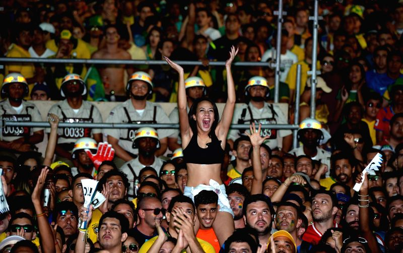 Fans react while watching a televised quarter-finals match between Brazil and Colombia of 2014 FIFA World Cup in Salvador, Brazil, on July 4, 2014. Brazil won 2-1 ..
