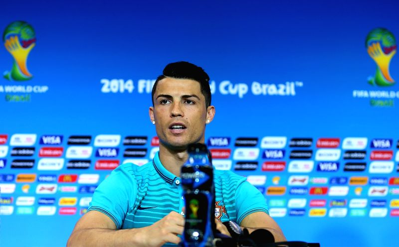 Portugal's Cristiano Ronaldo delivers a speech at a press conference at the Arena Fonte Nova Stadium in Salvador, Brazil, on June 15, 2014. A Group G match of 2014