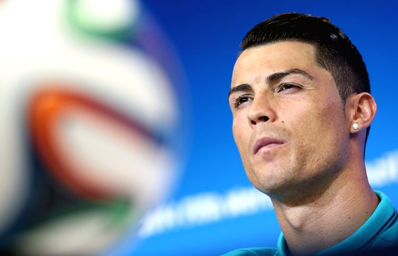 Portugal's Cristiano Ronaldo attends a press conference at the Arena Fonte Nova Stadium in Salvador, Brazil, on June 15, 2014. A Group G match of 2014 FIFA World ..