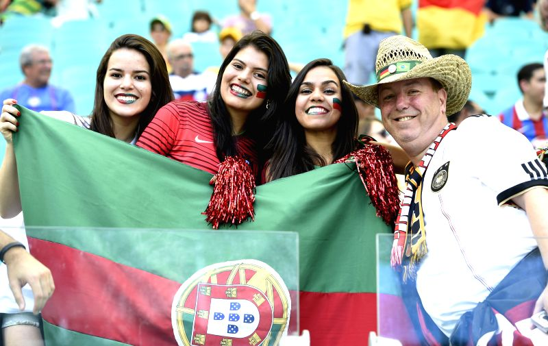 Fans pose before a Group G match between Germany and Portugal of 2014 FIFA World Cup at the Arena Fonte Nova Stadium in Salvador, Brazil, June 16, 2014. (Xinhua/Qi