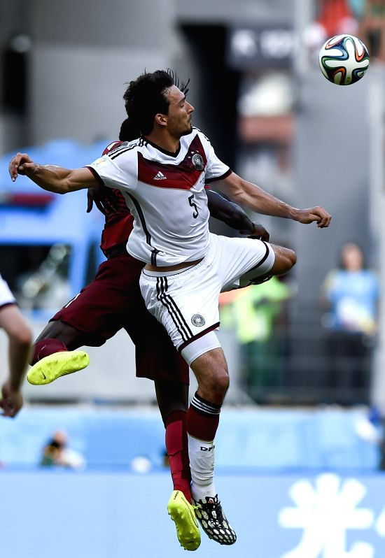 Germany's Mats Hummels competes for a header during a Group G match between Germany and Portugal of 2014 FIFA World Cup at the Arena Fonte Nova Stadium in ...
