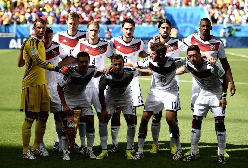 Germany's national team players pose for a group photo before a Group G match between Germany and Portugal of 2014 FIFA World Cup at the Arena Fonte Nova Stadium ..