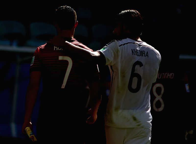 Germany's Sami Khedira talks with Portugal's Cristiano Ronaldo at the end of a Group G match between Germany and Portugal of 2014 FIFA World Cup at the Arena Fonte