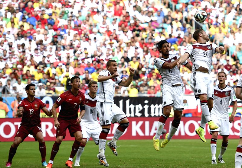 Germany's Shkodran Mustafi (1st R) jumps for a header during a Group G match between Germany and Portugal of 2014 FIFA World Cup at the Arena Fonte Nova Stadium in