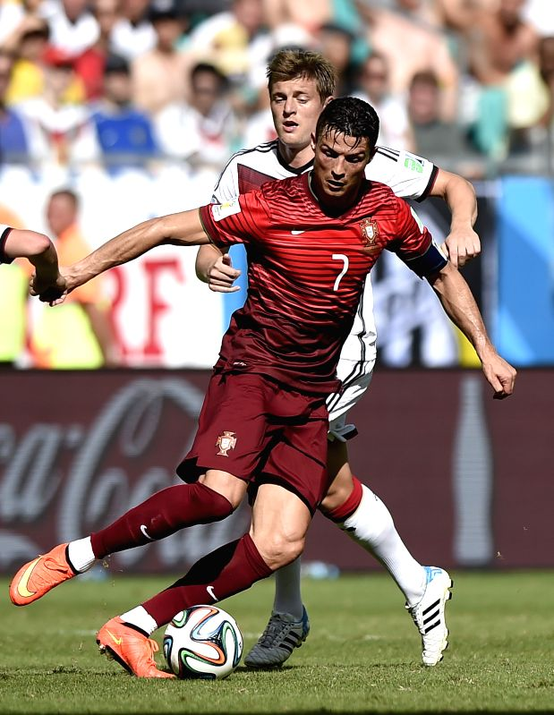 Portugal's Cristiano Ronaldo controls the ball during a Group G match between Germany and Portugal of 2014 FIFA World Cup at the Arena Fonte Nova Stadium in ...