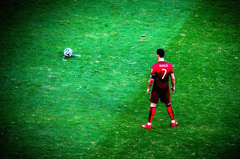 Portugal's Cristiano Ronaldo prepares for a free kick during a Group G match between Germany and Portugal of 2014 FIFA World Cup at the Arena Fonte Nova Stadium in