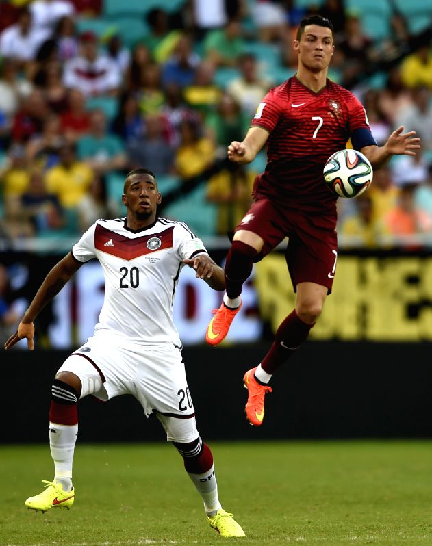 Portugal's Cristiano Ronaldo (R) competes with Germany's Jerome Boateng during a Group G match between Germany and Portugal of 2014 FIFA World Cup at the Arena ...