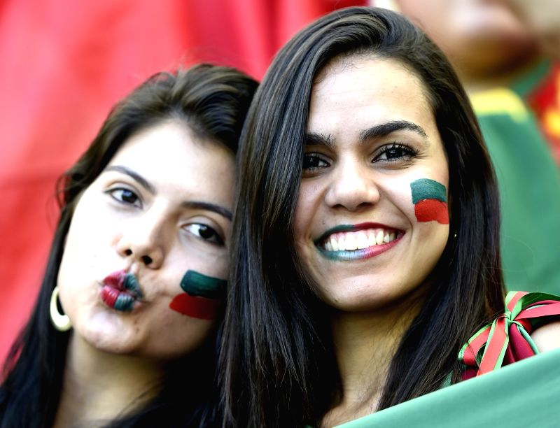 Portugal's fans pose before a Group G match between Germany and Portugal of 2014 FIFA World Cup at the Arena Fonte Nova Stadium in Salvador, Brazil, June 16, 2014.