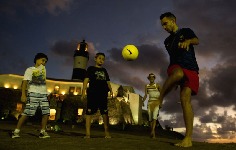 Brazilians play football on a square in Salvador, Brazil, on June 18, 2014. Photo: