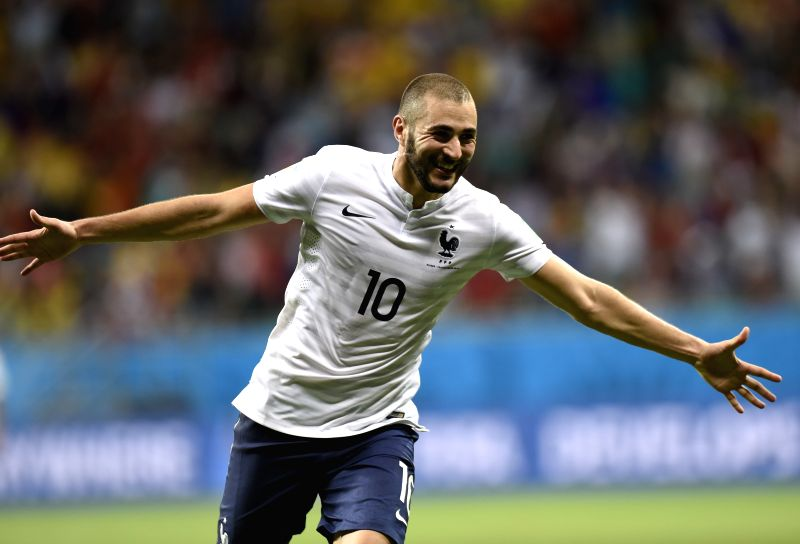 France's Karim Benzema celebrates the goal during a Group E match between Switzerland and France of 2014 FIFA World Cup at the Arena Fonte Nova Stadium in ...
