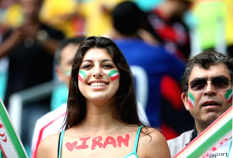 An Iran's fan poses before a Group F match between Bosnia And Herzegovina and Iran of 2014 FIFA World Cup at the Arena Fonte Nova Stadium in Salvador, Brazil, June