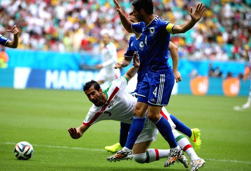 Iran's Ehsan Hajsafi falls down during a Group F match between Bosnia And Herzegovina and Iran of 2014 FIFA World Cup at the Arena Fonte Nova Stadium in Salvador, .