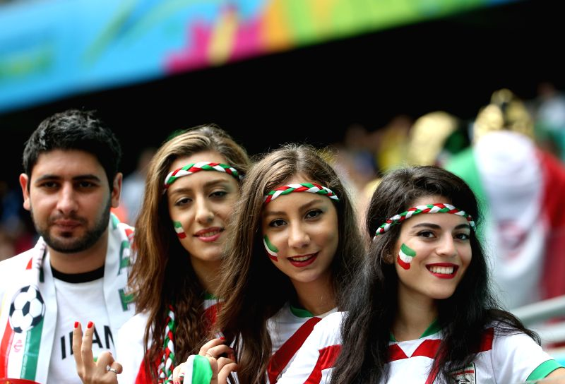 Iran's fans pose before a Group F match between Bosnia And Herzegovina and Iran of 2014 FIFA World Cup at the Arena Fonte Nova Stadium in Salvador, Brazil, June ...