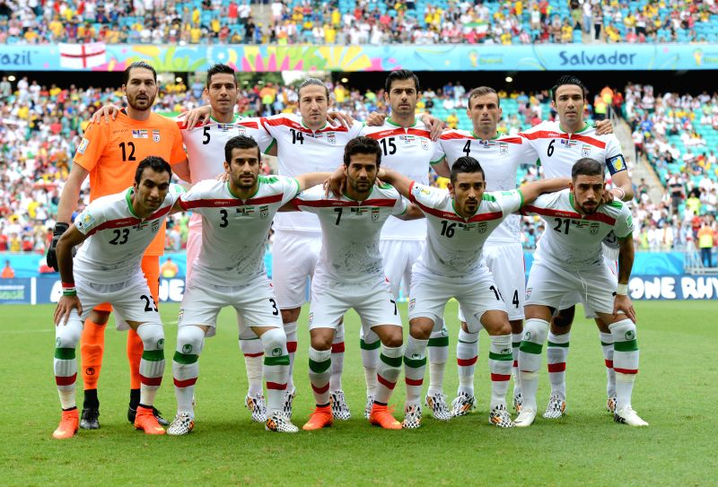 Iran's players pose for a group photo during a Group F match between Bosnia And Herzegovina and Iran of 2014 FIFA World Cup at the Arena Fonte Nova Stadium in ...