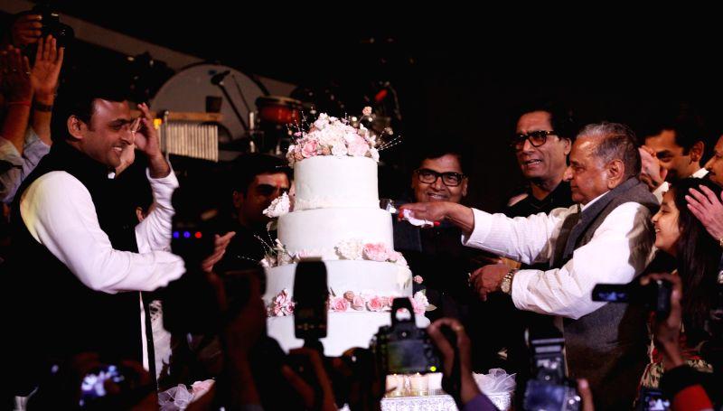 Samajwadi Party chief Mulayam Singh Yadav with his son and Uttar Pradesh Chief Minister Akhilesh Yadav  during his birthday celebrations at Safai, Uttar Pradesh on Nov 22, 2015. - Akhilesh Yadav and Mulayam Singh Yadav