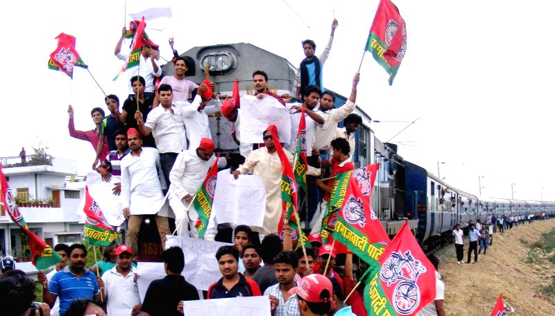 Samajwadi Party (SP) workers halt Gomti Express in protest against rail fare hike in Allahabad on June 21, 2014.