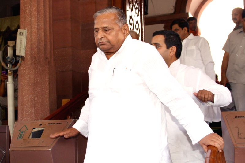 Samajwadi Party supremo Mulayam Singh Yadav in the Parliament after Union Railway Minister D.V. Sadananda Gowda presented rail budget 2014-15 in New Delhi on July 8, 2014. - D. and Mulayam Singh Yadav