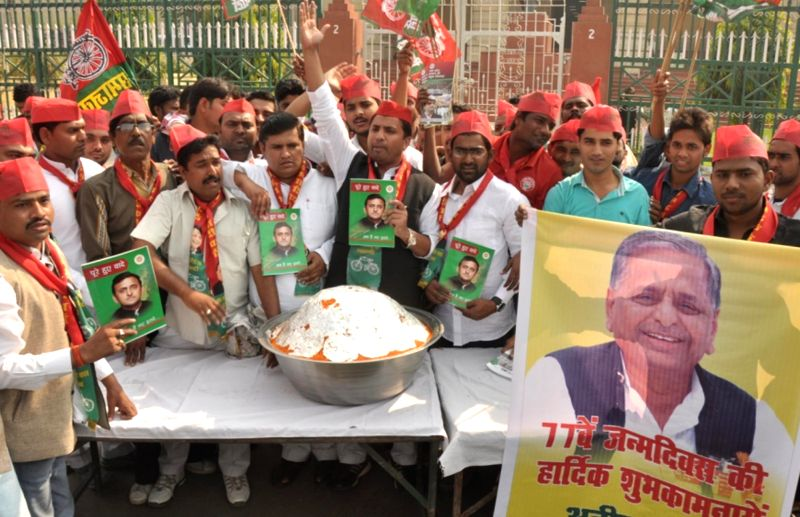 Samajwadi Party workers distribute laddoos on the eve of party chief Mulayam Singh`s birthday in Lucknow, on Nov 21, 2015.