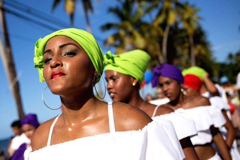 """Performers take part in the parade of the """"Carnival Waves of the Ocean 2015"""" in Las Terrenas of Samana Province, the Dominican Republic, March 7, 2015. ..."""