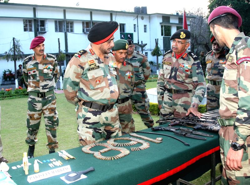 Army Commander of the Western Command, Lt Gen K J Singh takes a look at the weapons seized from militants, during his visit at Samba Military Station and met ...