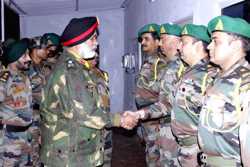 Colonel of the Sikh Regiment Lt Gen G S Shergill meets soldiers of Sikh Regiment deployed in Jammu and Kashmir's in Samba on March 18, 2015.