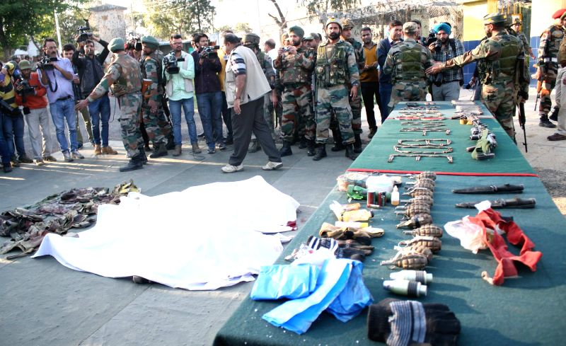 Soldiers show the arms and ammunition recovered from the militants who launched an attack on an army camp in Samba district of Jammu and Kashmir on March 20, 2015.