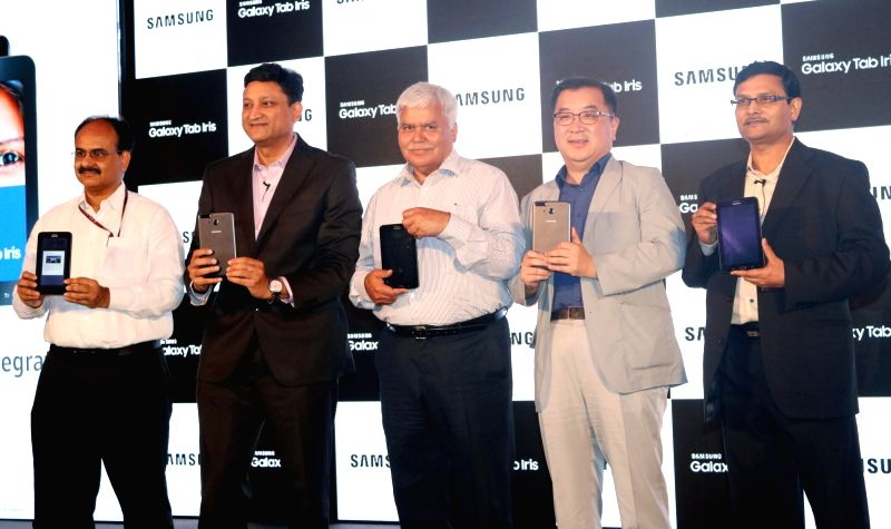 Samsung India electronic, senior vice president Ken Kang, vice president Sukesh Jain, and TRAI chairman RS Sharma during the launch of Samsung's first iris recognition-powered tablet in ... - Sukesh Jain