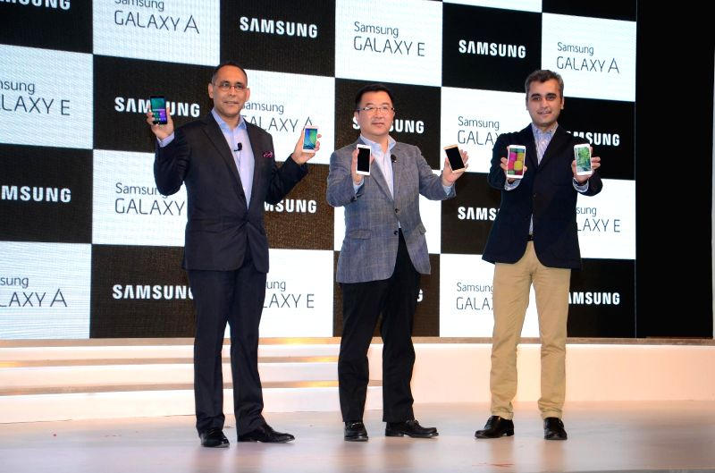 Samsung India, Mobile and IT, Vice president (Marketing) Asim Warsi, Samsung India, Mobile and IT, Senior Vice President Ken Kang and Samsung India, Mobile, Direction, Manu Sharma at the launch of a . - Manu Sharma