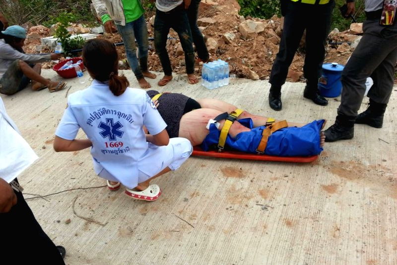 SAMUI, May 27, 2016 - A survivor receives medical treatment at the Koh Samui Island in southern Thailand, May 26, 2016. Two tourists died and five others were still missing late Thursday afternoon ...