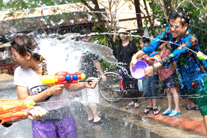 People take part in a watergun battle during the celebration of Songkran, the water festival, in Samut Prakan Province near Bangkok, Thailand, April 14, 2014.