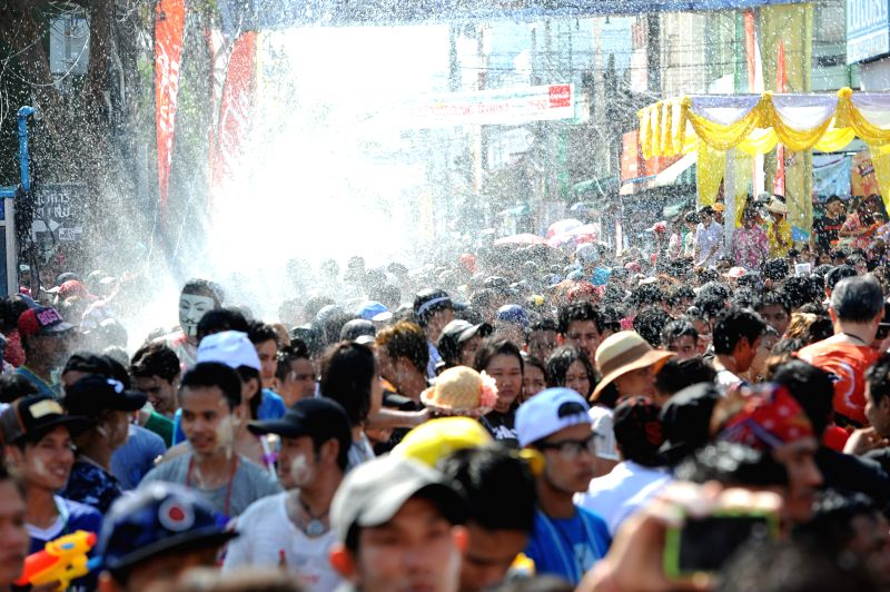 SAMUT PRAKAN, April 23, 2017 - Local people join in a carnival procession to celebrate the Songkran Festival amid showers of water in Phra Pradaeng District of central Thailand's Samut Prakan ...