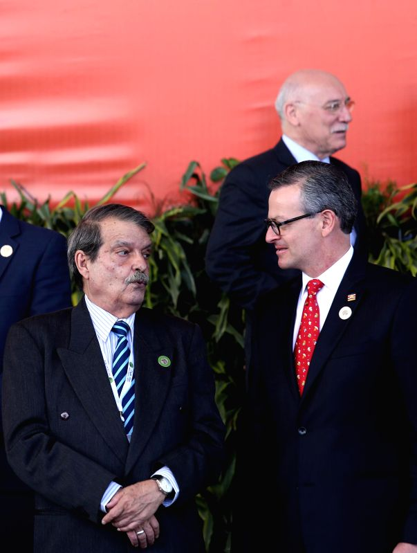 Cuba's Vice Foreign minister Abelardo Moreno (L) speaks with his Costa Rican counterpart Manuel Gonzalez (R) during a group photo session for foreign .. - Abelardo Moreno