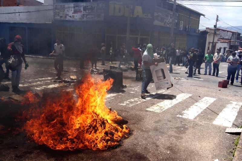 Demonstrators face up with elements of Bolivarian National Police during a protest against the government of Venezuelan President Nicolas Maduro, at the city ...