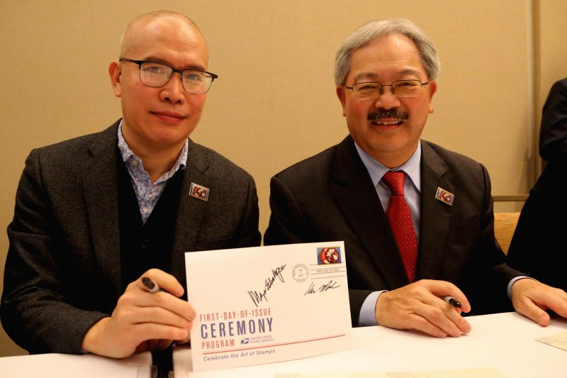 Edwin Lee (R), mayor of San Francisco, and Kam Mak, designer of the stamp featuring the Chinese lunar Year of the Goat, show the first-day cover in San ...