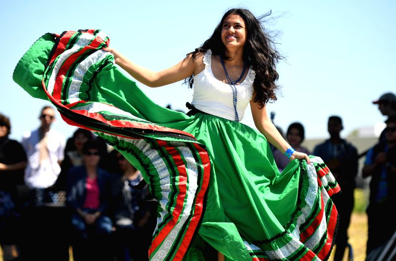 SAN FRANCISCO, June 9, 2018 - Salvadoran students dance during the international day event at San Mateo Adult school, California, the United States, on June 8, 2018. Students from nearly 20 countries ...