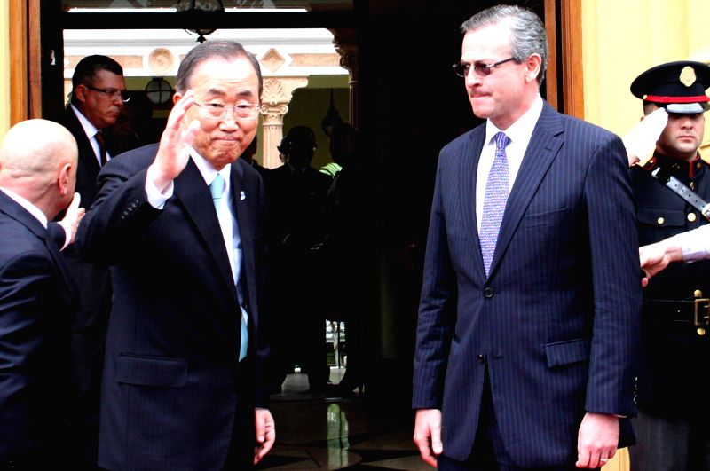 The UN Secretary General Ban Ki-moon (L front), accompanied by Costa Rica's Minister of Foreign Affairs Manuel Gonzalez (R front), waves during his visit to San ...