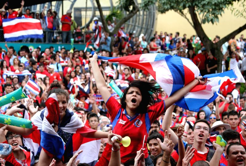 (Costa Rica's supporters celebrate after a Group D match between Costa Rica and Endland of 2014 FIFA World Cup, at the Democracy Square in San Jose, capital of ...