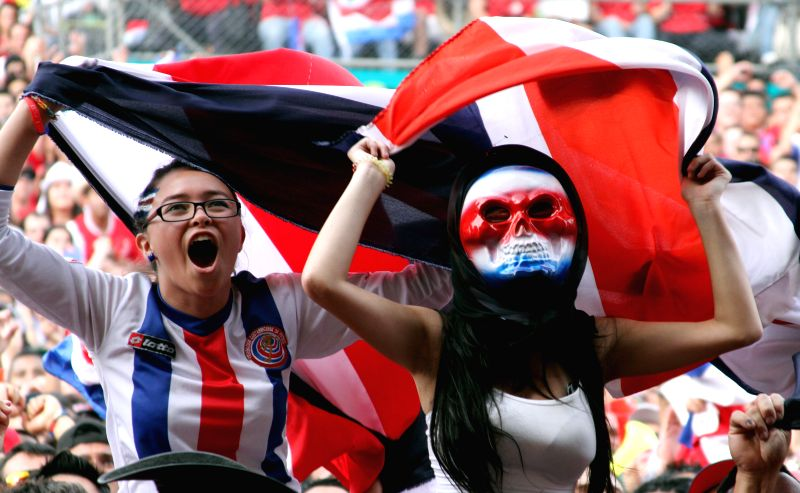 Costa Rica's fans pose before a Round of 16 match between Costa Rica and Greece of 2014 FIFA World Cup in San Jose, capital of Costa Rica, on June 29, 2014.