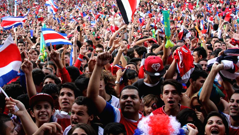 Costa Rican fans react during a Round of 16 match of 2014 FIFA World Cup Brazil between Costa Rica and Greece, in the Democracy Square, in San Jose, Costa Rica, on