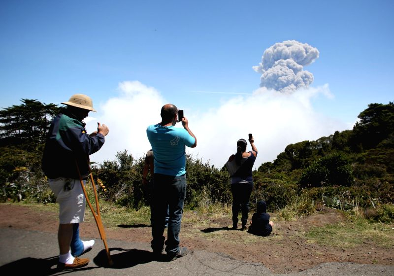 People take photos of smoke rising from Turrialba volcano in Turrialba, Costa Rica, March 13, 2015. Since Thursday, the Turrialba volcano recorded eruptions of ...
