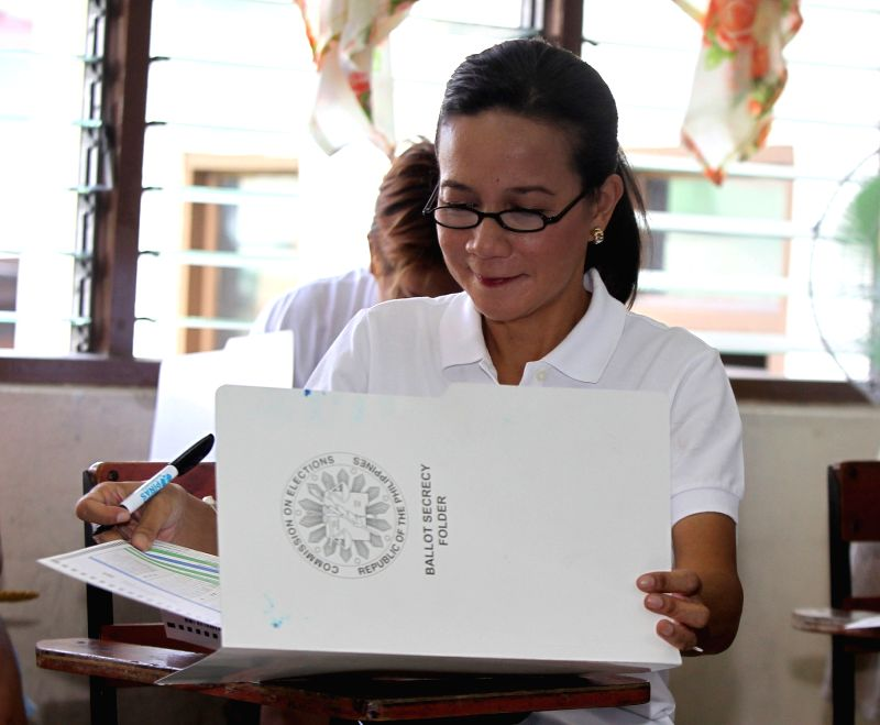 SAN JUAN CITY, May 9, 2016 - Presidential candidate Senator Grace Poe casts her vote inside a classroom turned into a polling precinct at a school in San Juan City, the Philippines, May 9, 2016. ...