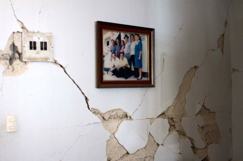 A picture is hung on a cracked wall after an earthquake, in San Pedro Sacatepequez, Guatemala, on July 7, 2014. At least one person was killed when an ..
