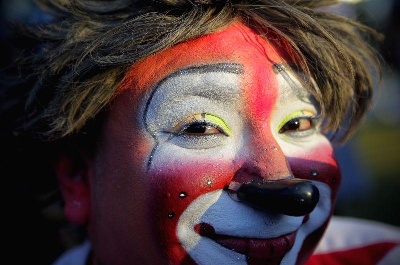 "San Salvador: A Salvadoran clown takes part in a show at the Beethoven Fountains marking the ""National Day of the Salvadoran Clown"" in San Salvador, capital of El Salvador, on Dec. 3, 2014."
