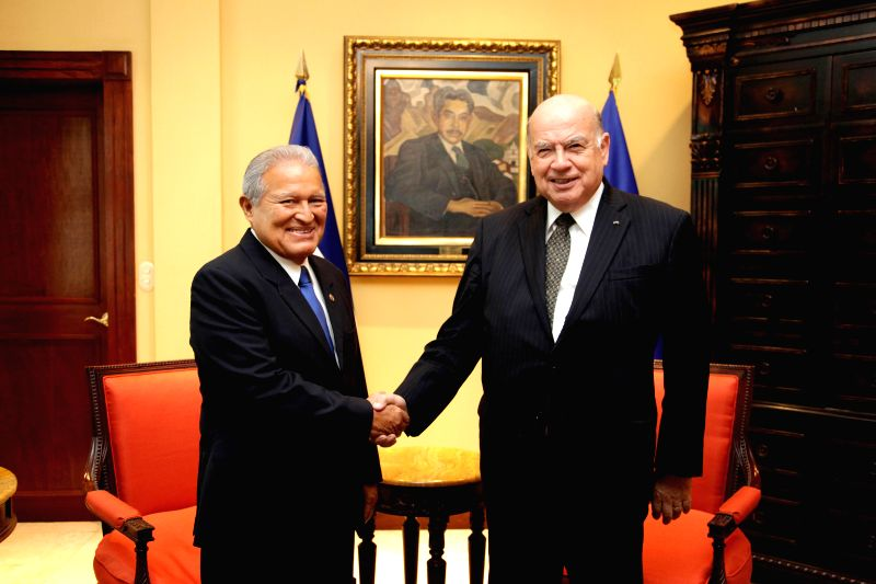 Image provided by El Salvador's Presidency shows Salvadorean President, Salvador Sanchez Ceren (L), shaking hands with the Secretary-General of the ...
