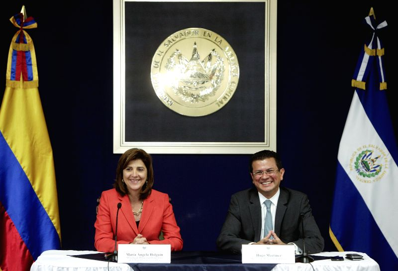 Salvadoran Chancellor Hugo Martinez (R) attends a meeting with his Colombian counterpart Maria Angela Holguin after the signing of an agreement, in the ...
