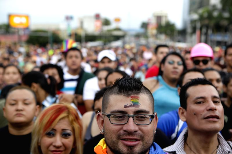People attend a march commemorating the sexual diversity of the Lesbian, Gay, Bisexual and Transexual (LGBT) community in San Salvador, capital of El Salvador,